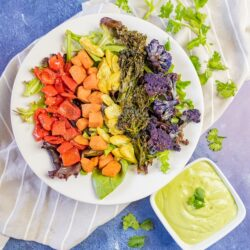 Rainbow Buddha bowl with red, orange, yellow, green, and purple vegetables