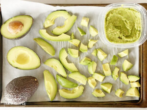 Different sized avocado slices on a tray