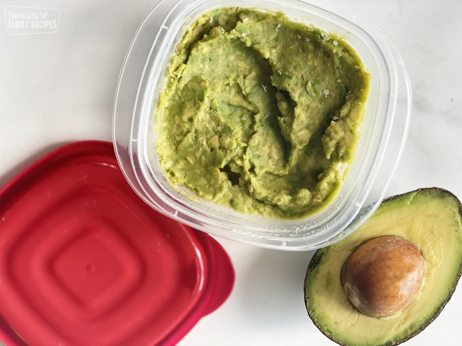 Mashed avocado in a container to be frozen