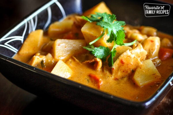 Chicken Massaman Curry with potatoes in a square black dish