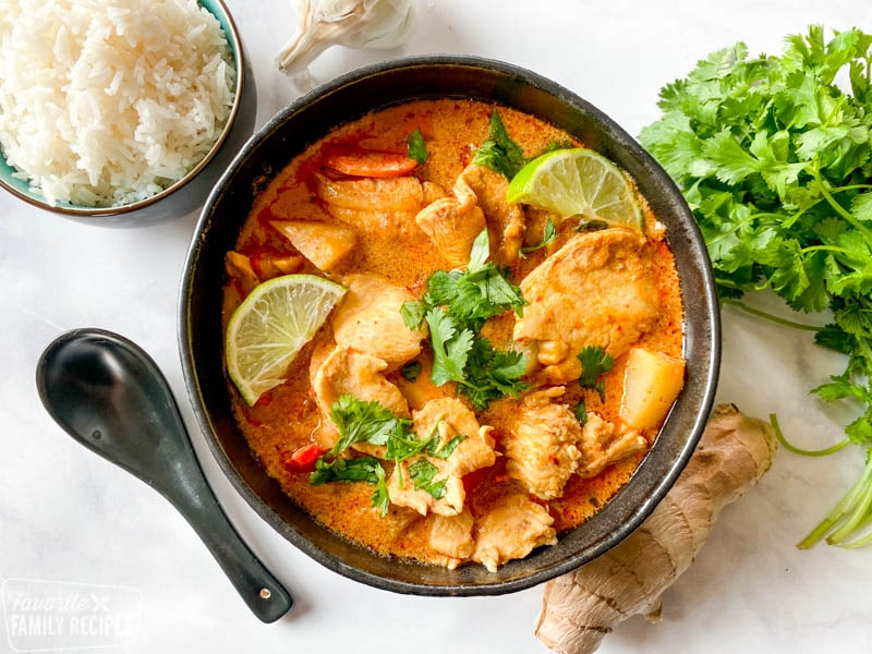Chicken Massaman Curry in a black bowl garnished with cilantro