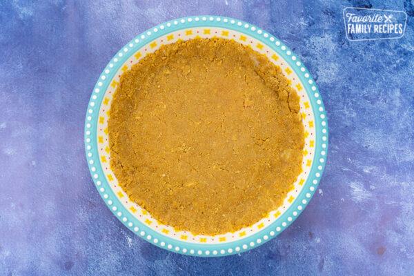 graham cracker crust in a pie dish