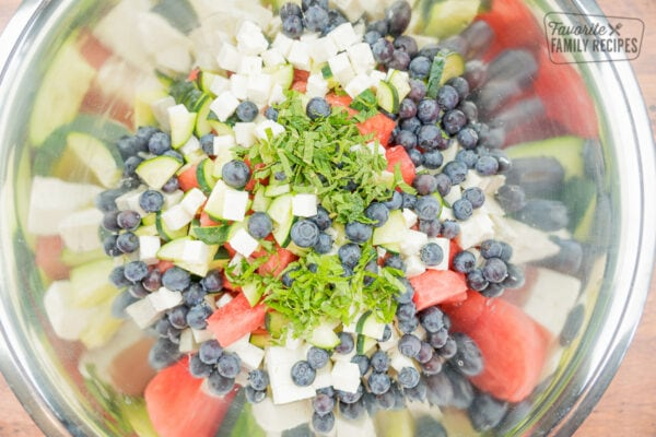 Mint and basil leaves on top of watermelon feta salad