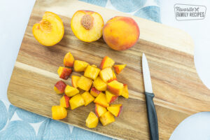 Cubed peaches on a cutting board