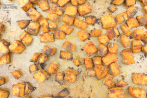 Crispy sweet potatoes on a baking pan