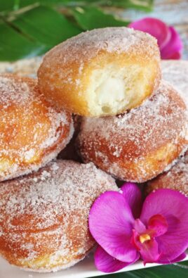 malasadas on a plate showing haupia filling