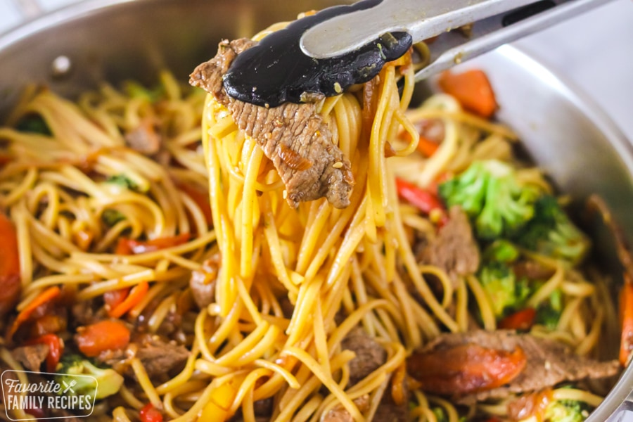 Beef Stir Fry being served with tongs