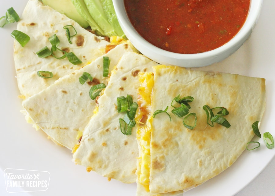 breakfast quesadilla wedges on a plate with salsa