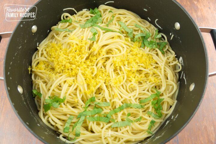 Pasta topped with lemon sauce, basil, and lemon zest.