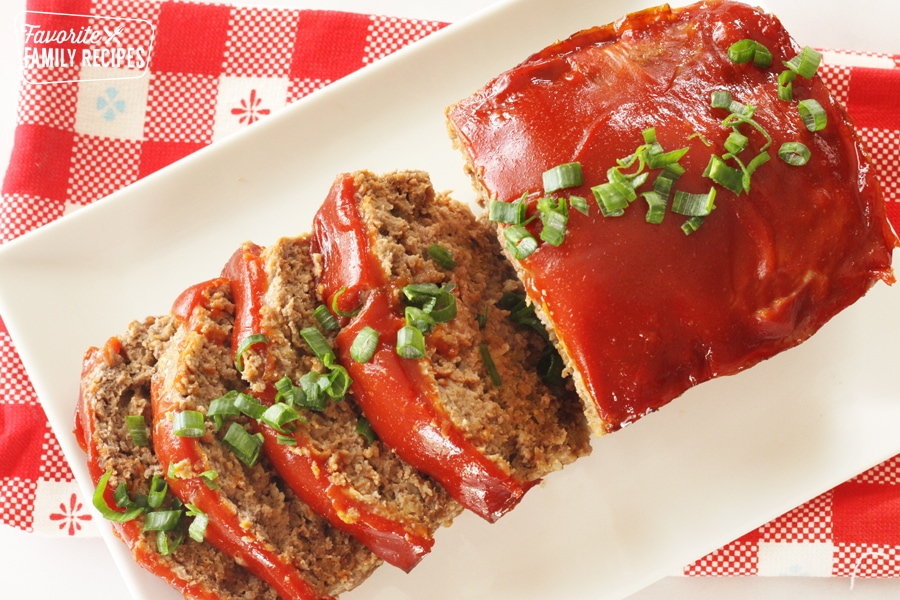 Meatloaf on a plate with ketchup glaze