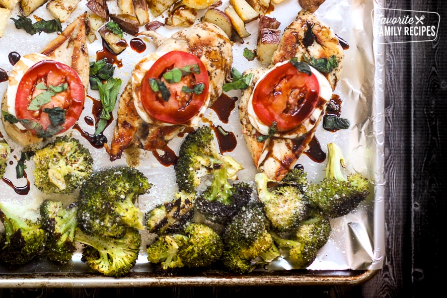 A sheet pan filled with chicken, potatoes, and broccoli
