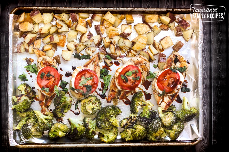 Caprese chicken, herbed potatoes, and broccoli roasted on a sheet pan