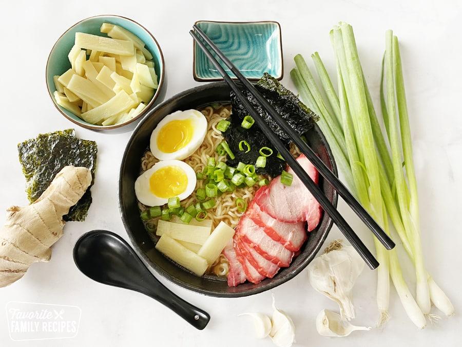 shoyu tamen in a bowl next to ingredients