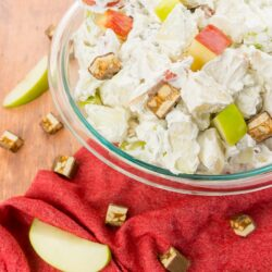 snickers apple salad in a glass bowl