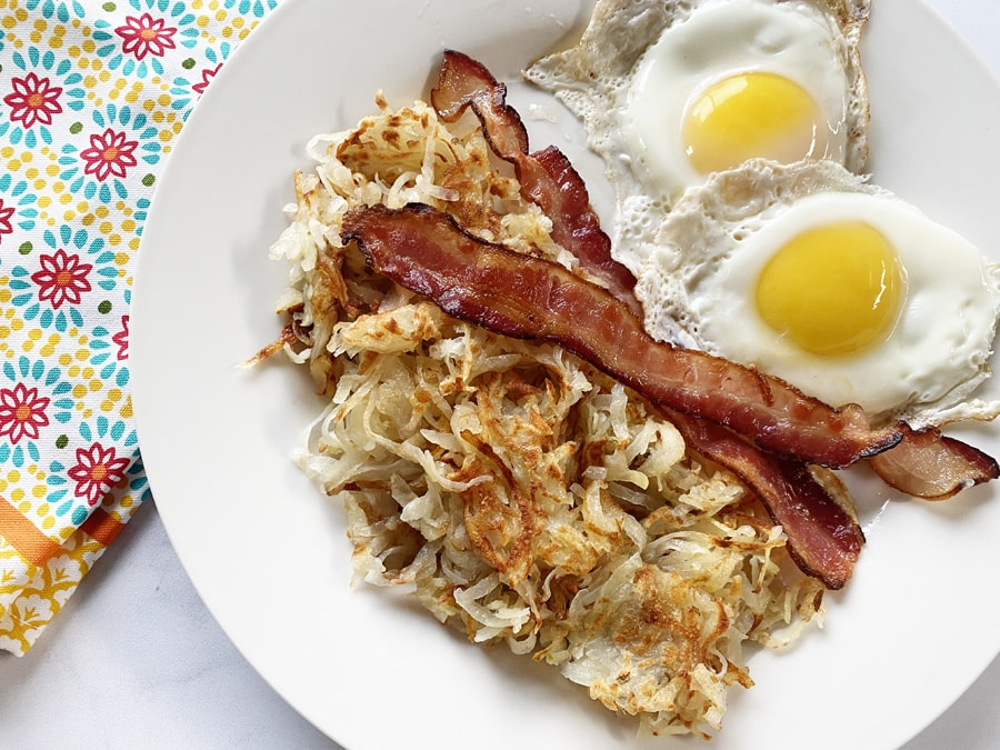 Hash browns with bacon and eggs for breakfast