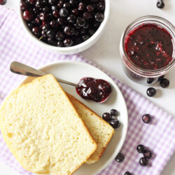 spoonful of huckleberry jam on a plate with bread