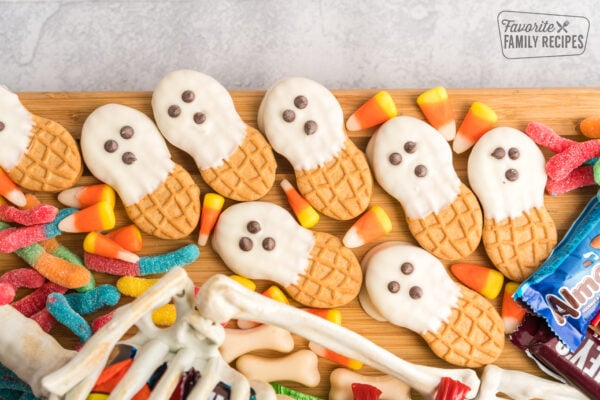 Ghosts made out of Nutter Butters dipped in white chocolate with mini chocolate chip eyes.