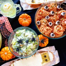 halloween spaghetti dinner with salad and garlic bread on a table