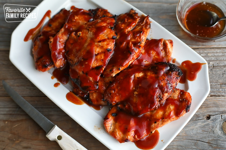 Honey BBQ Chicken breasts on a white platter