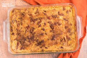 Baked pumpkin cobbler in a glass casserole dish