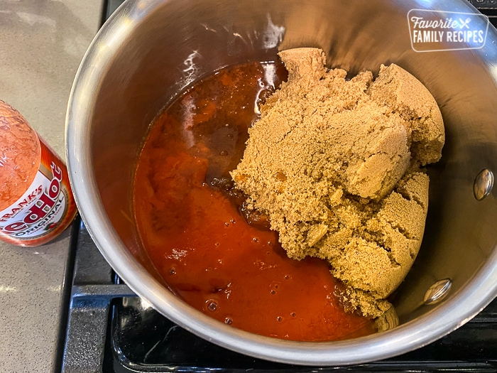 Chicken wing sauce ingredients in a pan