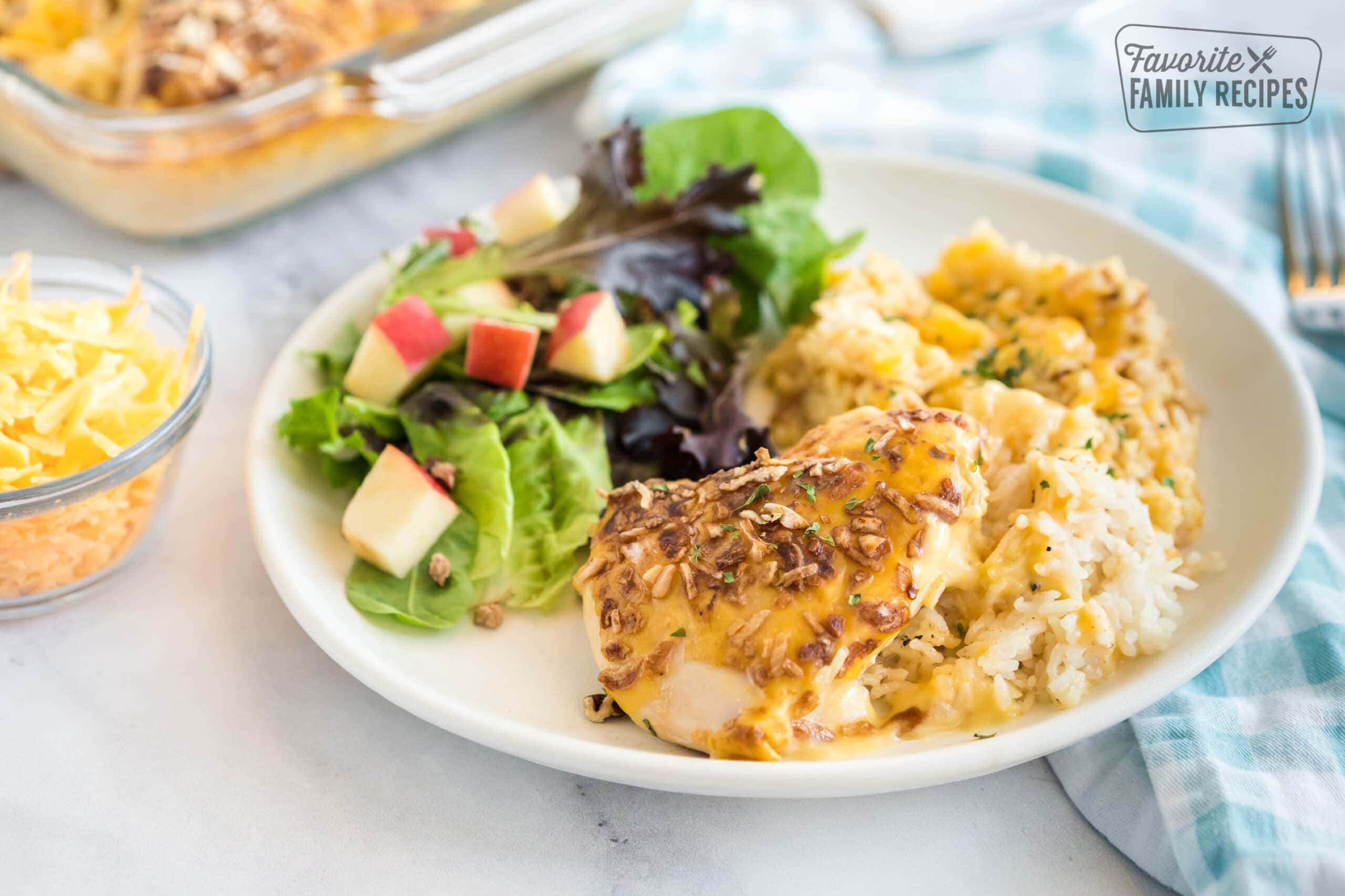 Chicken and rice casserole on a plate with salad