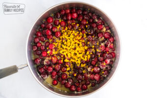 Cranberries, orange juice, sugar, and orange zest in a saucepan
