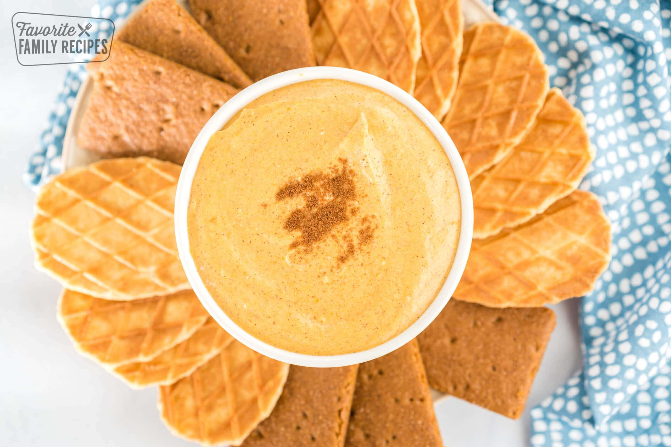Pumpkin dip in a bowl sprinkled with cinnamon