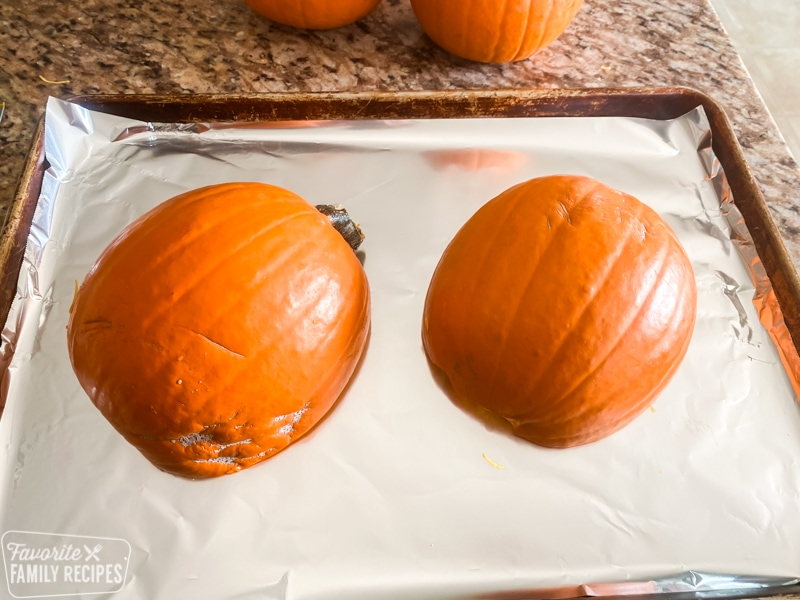 Pumpkins cut in half and ready to be roasted