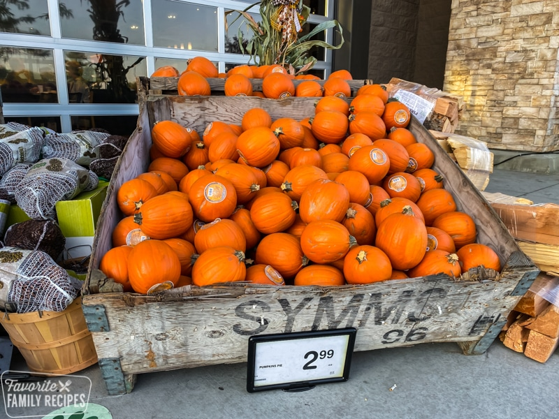 Large wooden crate full of pumpkins