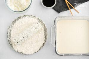Shrimp tempura roll dipped in flour and tempura batter