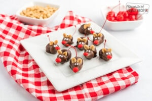Chocolate cherry mice on a white plate with a red gingham napkin