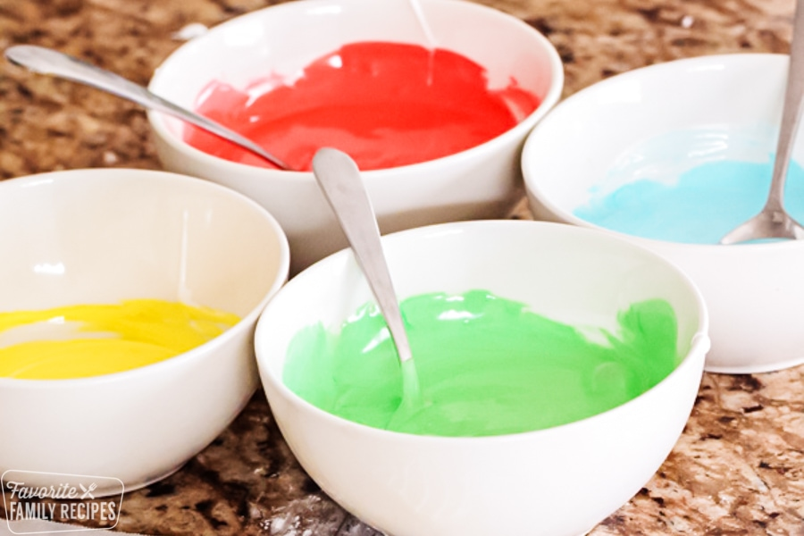 Royal icing for Christmas cookies in bowls