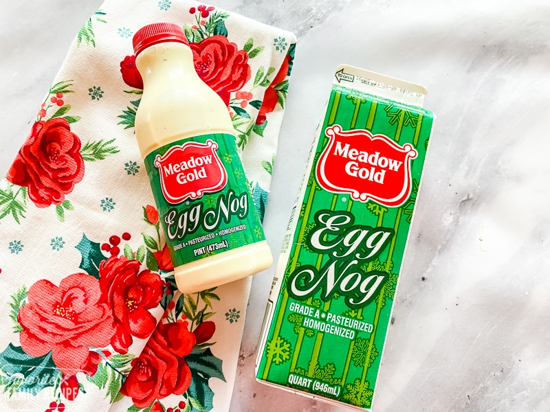 Eggnog bottle and carton on a table