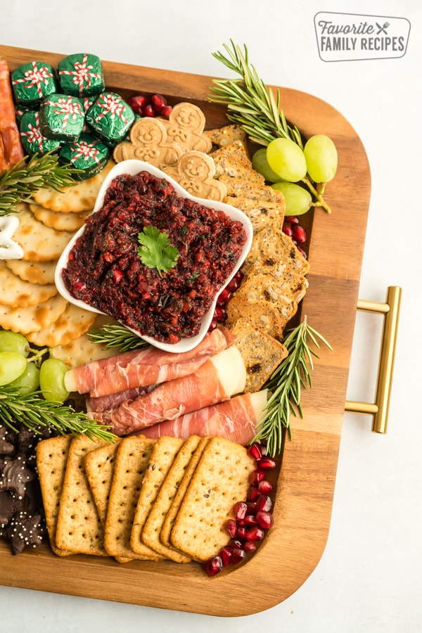 Part of a Christmas Charcuterie Board on a wooden try with gold handles