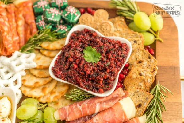 Cranberry Salsa in a small bowl on a charcuterie board