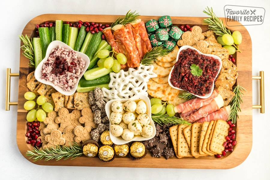 A Christmas Charcuterie Board on a wooden tray