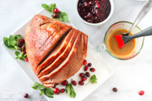 Large ham with cider glaze and cranberries