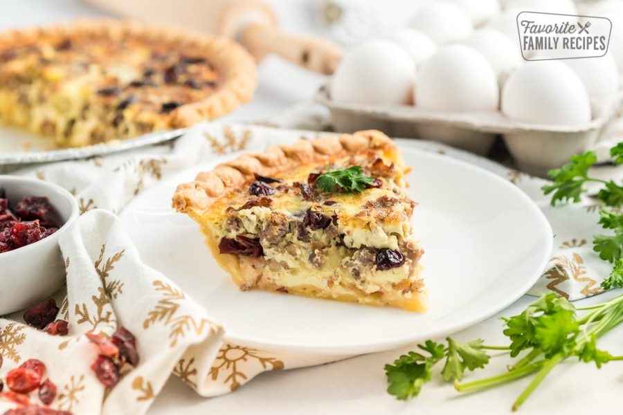 A slice of Christmas Breakfast Quiche on a white plate