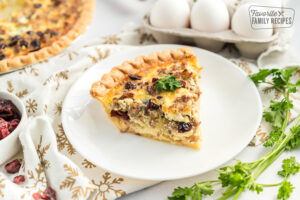 A slice of Christmas Breakfast Quiche on a plate
