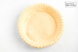 An empty partially baked pie crust