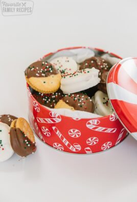 A Christmas tin filled with dipped ritz cookies