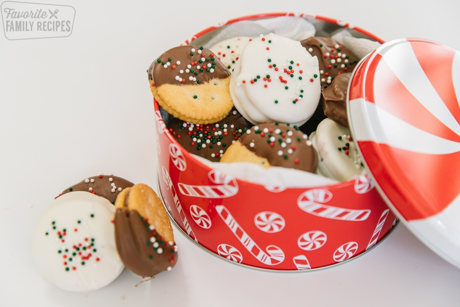 Dipped Ritz cookies in a Christmas tin