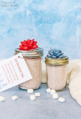 Two jars filled with hot chocolate mix with gift tags attached