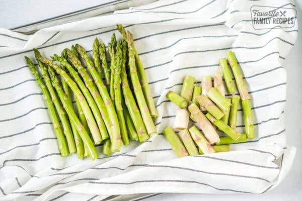 Trimmed asparagus on a dish cloth in preparation to make oven roasted asparagus