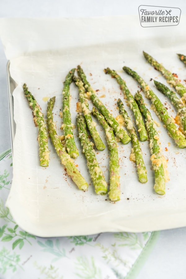 Roasted Asparagus on a parchment paper lined baking sheet