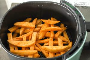 Fries arranged in air fryer