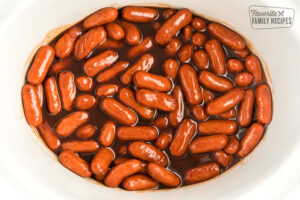 Lil smokies in sweet bbq sauce in a crock pot