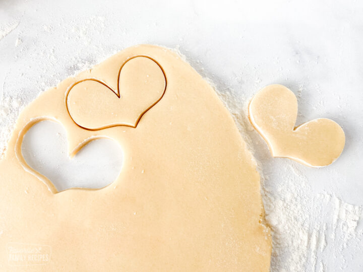 Sugar cookie dough with cut out hearts