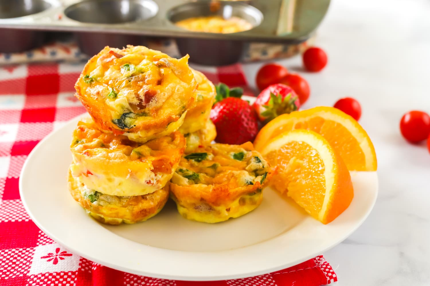 Egg muffins on a plate with fruit